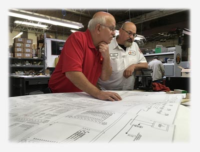 LECO Programming Supervisor and Panel Shop Supervisor Reviewing Panel Design